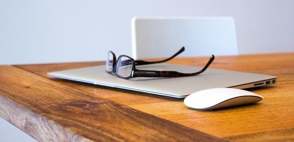 Glasses on laptop next to magic mouse - Should I Start a Blog?