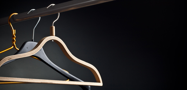 Three clothes hangers in a minimalist closet - how to get rid of clothes
