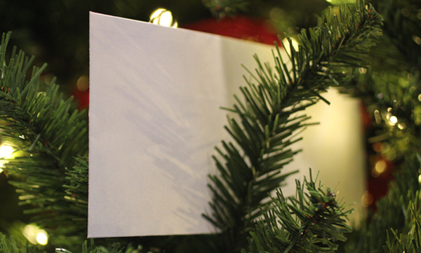 It's just a small, white envelope stuck among the branches of our Christmas tree. No name, no identification, no inscription. But it quickly became our family's favorite tradition.