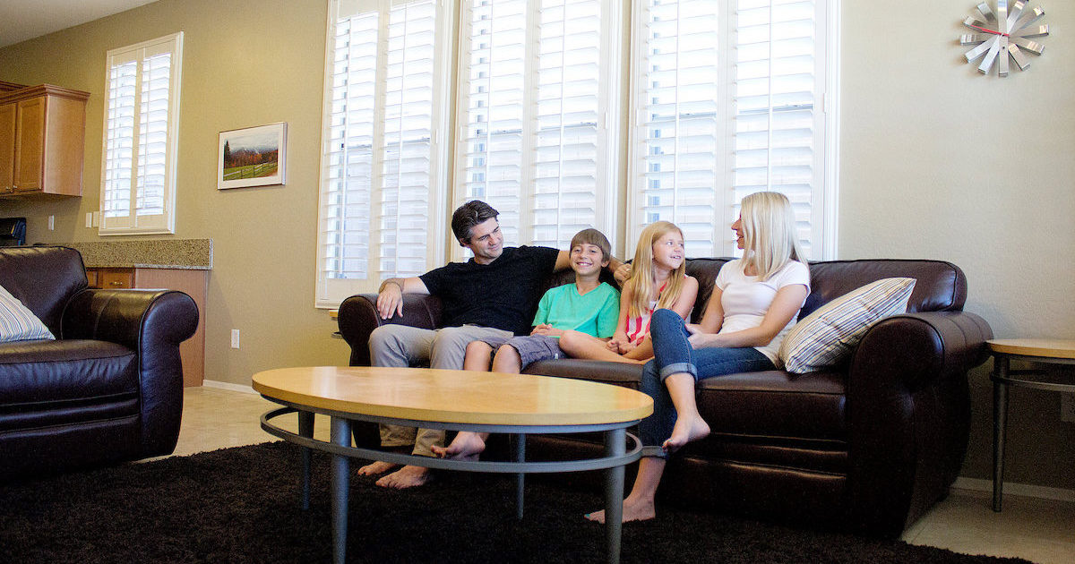 Joshua Becker and his minimalist family sitting on their couch